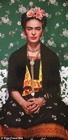 The Mexican artist Frida Kahlo is famous for wearing the accessories of flowers and gold earrings and jewelry.