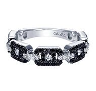 Black diamond stackable 14k white gold ring by Gabriel & Co. that is perfect for those who wear black almost everyday or all the time! This stackable ring is so gorgeous with all the black diamonds and diamonds almost resembling a belt.