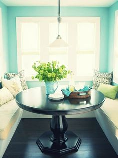 Aqua walls, dark floor and table and light accents.. pop of color! This is the cutest, brightest nook! Super chic!