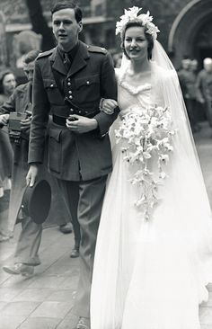 Photo of a Wedding. British society girls also married in wartime, including Deborah Mitford, aged one of the famed Mitford sisters, who married Andrew Cavendish in 1941 and later became the Duchess of Devonshire. Chic Vintage Brides, Vintage Wedding Photos, Vintage Bridal, Vintage Weddings, Royal Brides, Royal Weddings, Bridal Gowns, Wedding Gowns, 1940s Wedding Dresses