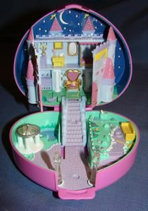 Starlight Castle.  My favourite Polly Pocket compact.  When you press the switch near the yellow bench, the stars light up.