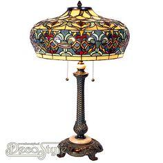 Tiffany Tafellamp Trenaka  Een bijzonder mooie tafellamp. Helemaal met de hand gemaakt van echt Tiffanyglas. Dit originele glas zorgt voor de warme uitstraling. De voet is vervaardigd van bronskleurig metaal en marmer. Met 2x grote fitting (E27). Met 2 schakelaars aan de kap. Afmetingen: Hoogte: 71 cm Diameter Kap: 47 cm