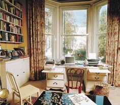 Margaret Drabble:The most striking aspect of this view of my room is the black lacquer jigsaw-puzzle table. I purchased this from Habitat last year because I am writing a book which is in part about jigsaws, and therefore it qualifies as research.