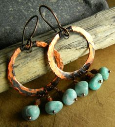 Hammered copper hoop earrings with sea green Russianamazonite nugget beads. I love the color combo of rust and green, so this is a natural. I fashioned the hoops from cut sheet copper and hammered the surface and edges for a rustic look. The amazonite nuggets are complemented by orange Picasso Czech glass beads and hang from the hoops on copper ball head pins.  #indiemade
