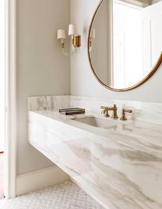 Floating vanities, round mirrors and gold fixtures and accents are what's trending. The gold fixtures add warmth to the current gray neutral palate trend.