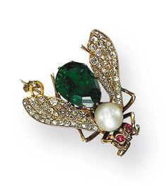 A CHARMING ANTIQUE PEARL, EMERALD AND DIAMOND FLY PIN  The body set with a pearl measuring approximately 7.40 mm, and a pear-shaped emerald weighing approximately 5.35 carats, extending pavé-set diamond wings, with cabochon ruby eyes, mounted in 18K gold, circa 1880