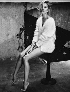 Taking a seat, Karolina Kurkova models angora cardigan from Versace for Glamour Magazine Italy November 2016