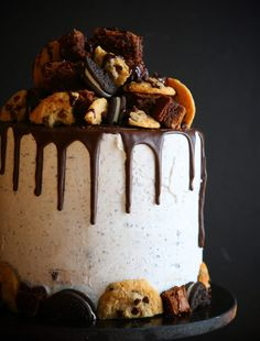 Ultimate Brownie Oreo Chocolate Chip Cookie Cake -- Layers of Chocolate and White Cake, separated by Brownie Bits, Oreos, Chocolate Chip Cookies, Whipped Vanilla Oreo and Chocolate Buttercream
