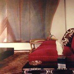 One of the greatest interiors of the 60s - Mary McFadden's drawing room in Bryanston, South Africa. Morris Louis painting, Eighteenth-century Bessarabian carpet, regency rope stool and the killer - a deliciously rich red sofa in wide-wale corduroy.