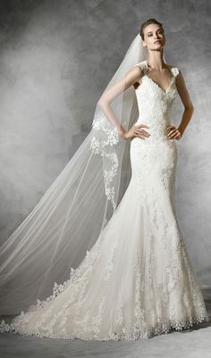 Try this mermaid wedding dress with sweetheart neckline in petit pois tulle and guipure, with straps and daring semi-sheer back with appliqués. Flared skirt with appliqués and scalloped hem. From Pronovias. Available at Schaffer's in Des Moines, Iowa. Wedding Dress Info: PRONOVIAS – STYLE LAREN.
