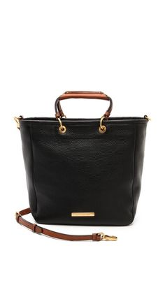 Just bought this Marc bag; it's a perfect balance between black and camel brown. Stunning!