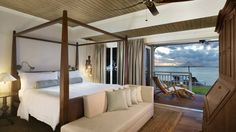 Overlooking sparkling waters and just feet from the resort's white sand beach, Beachfront St. Regis Suites offer rare island opulence from sunrise to sundown thanks to an eight-square-metre balcony.