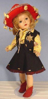 I still have this doll sans the clothing!! vintage cowgirl doll