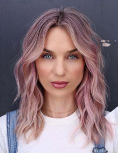 See here the beautiful pink hair color shades to wear in these days. Women who are looking for pink hair colors they can browse here to see the most amazing ideas of pink hair colors that we have posted in this article. No doubt which type of hair textures you have, just see here & choose these amazing pink hair color.