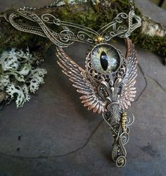 SOLD Gothic Steampunk Cat Evil Eye Necklace with Wings. $149.95, via Etsy.
