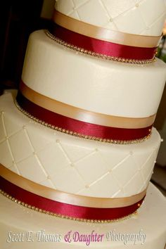 Ivory, burgundy and gold buttercream wedding cake with quilt pattern and sugar beads.  | Kansas City Wedding Cakes |