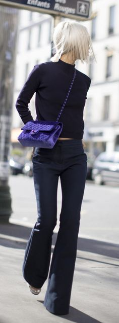 Vanessa Hong is wearing a dark blue flared jeans from Coach