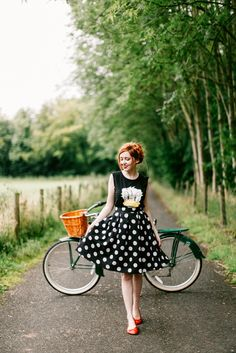 Gorgeous! Love the whimsy added by the Donald Duck top with the gorgeous polka dot skirt and cute red flats! #stylegallery