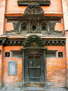An ornately carved wooden door in the Naga Bahal courtyard behind the Golden Temple  Patan,Lalitpur,Nepal