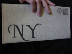 NY Cotton Canvas Envelope Clutch Bag. (I have this, and love it! I need one that says Queens next!)