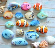 Fish painted rocks by Maria Michela Troccolo Powered by RocKStreet Collective Painted Rock Animals, Painted Rocks Craft, Hand Painted Rocks, Pebble Painting, Pebble Art, Stone Painting, Stone Crafts, Rock Crafts, Arts And Crafts