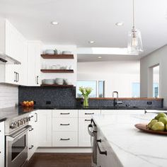 open area over sink, wood open shelving, tiled backsplash