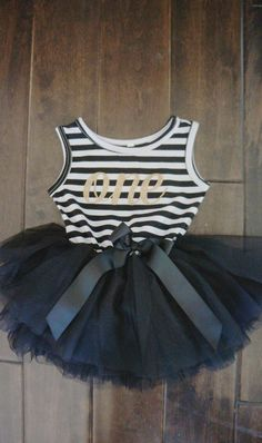 This is the perfect dress for your birthday girl, disney trip or halloween. The dress is made complete with a bow and full tulle skirt! The