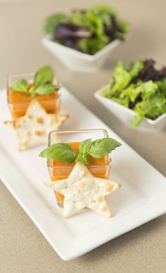 creamy tomato soup with fresh basil on top, and included some mini salads and star crackers.