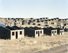 David Goldblatt  'Incomplete houses, part of a stalled municipal development of 1000 houses. Lady Grey, Eastern Cape, 5 August 2006′  2006