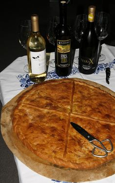 Iconic Wine & Food Experiences. A Galician empanada, stuffed with tuna and onions, served with a selection of wines from top Ribeiro producer, Manuel Formigo. Photo by Gerry Dawes©2012 / gerrydawes@aol.com / Facebook / Twitter / Pinterest.