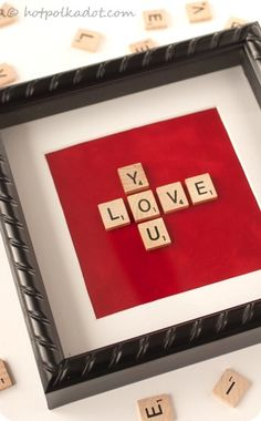 As much as my husband i play this game, we need this on our wall.  Two romantic Scrabble crafts.