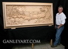 Dave Ganley woodworking... elk in stream: very detailed and intricate wood carving done all by hand.