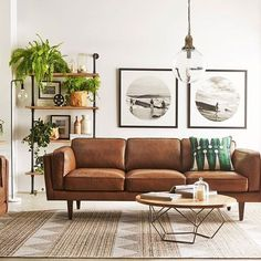 Tan leather sofa with pendant light