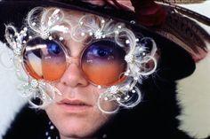 EltonJohn in feathered glasses - 1974