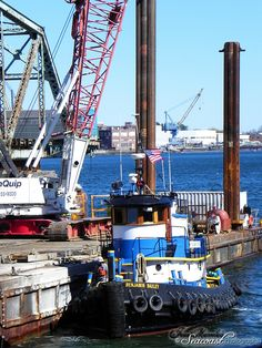 Tug boat working to remove the Memorial Bridge south span.   Seacoast Photographs http://www.seacoastphotographs.com