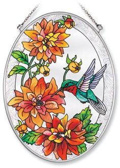 Amia Hand Painted Glass Suncatcher with Dahlia and Rubythroat Hummingbird Design, 5-1/4-Inch by 7-Inch Oval by Amia. $19.00. Handpainted glass. Comes boxed, makes for a great gift. Includes chain. Amia glass is a top selling line of handpainted glass decor. Known for tying in rich colors and excellent designs, Amia has a full line of handpainted glass pieces to satisfy your decor needs. Items in the line range from suncatchers, window decor panels, vases, votives and ...