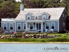 New England beach house-I'm picturing a cape cod layout inside and wouldn't change too much on the outside-gorgeous and serene setting.