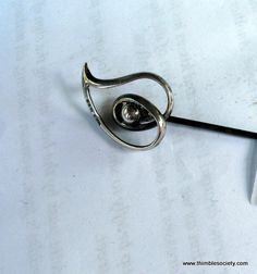 Silver hat pin, articulated head