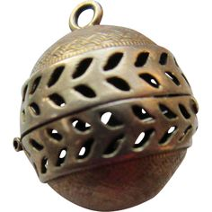This tiny vinaigrette locket was intended to hold a small sponge soaked in aromatic vinegars or oils. ..