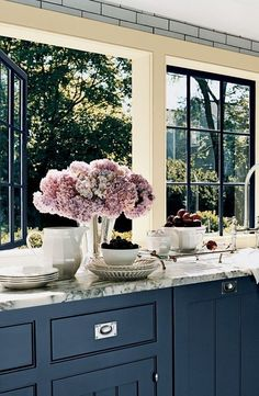 13 pretty kitchen windows. you're welcome. (domino)