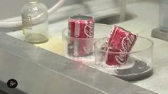 Here's what happens to Coke cans in hydrochloric acid and sodium hydroxide: