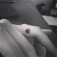 This wee little paw print.   31 Beautiful Dog Tattoos Every Dog Lover Will Appreciate