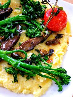 Polenta with roasted vegtables and a boiled egg, prepared fish or yes indeed meat....