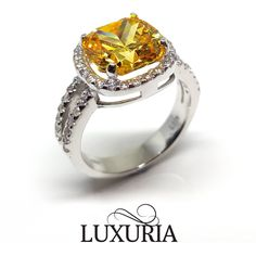 Fancy vivid yellow diamond engagement ring from Luxuria Jewellery New Zealand