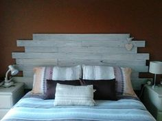 new bedhead made from old fence pailings then white washed