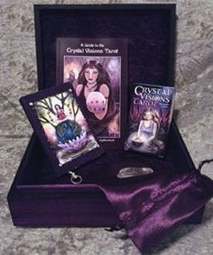 Crystal Visions Tarot Deck Sets featuring the CVT deck, a purple silk tarot pouch, and Crystal. CVT Ultimate Set features a hand-crafted tarot box, journal, deck & companion book!