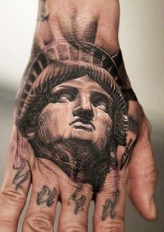 Statue of Liberty hand tattoo