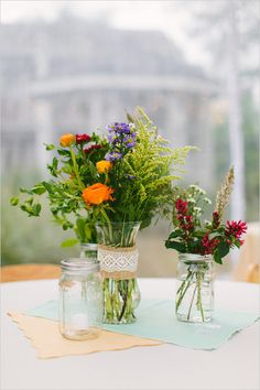 Vibrant mix and match floral centerpieces