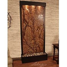 The Tranquil River Floor Fountain is a water feature with a simple, nature-inspired design that will enhance any room in your home or office. The frame is made of powder coated steel or copper and the panel is a rear mounted as it is designed to sit flush against a wall.
