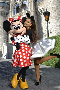 Ariana Grande from Stars at Disneyland & Disney World The singer poses with Minnie Mouse during a break from taping the Disney Parks Unforgettable Christmas Celebration TV special in Florida.